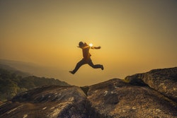 Man Leaping on Rocks