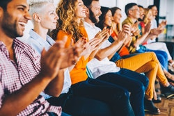 Conference attendees applaud expert speakers