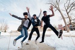 Three people jumping