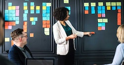 Woman with post it notes on a board
