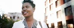 black woman looks hopeful at what 2021 will hold