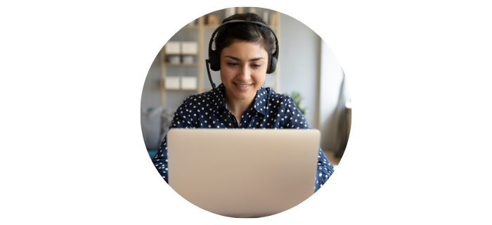 Person at the computer with headphones on